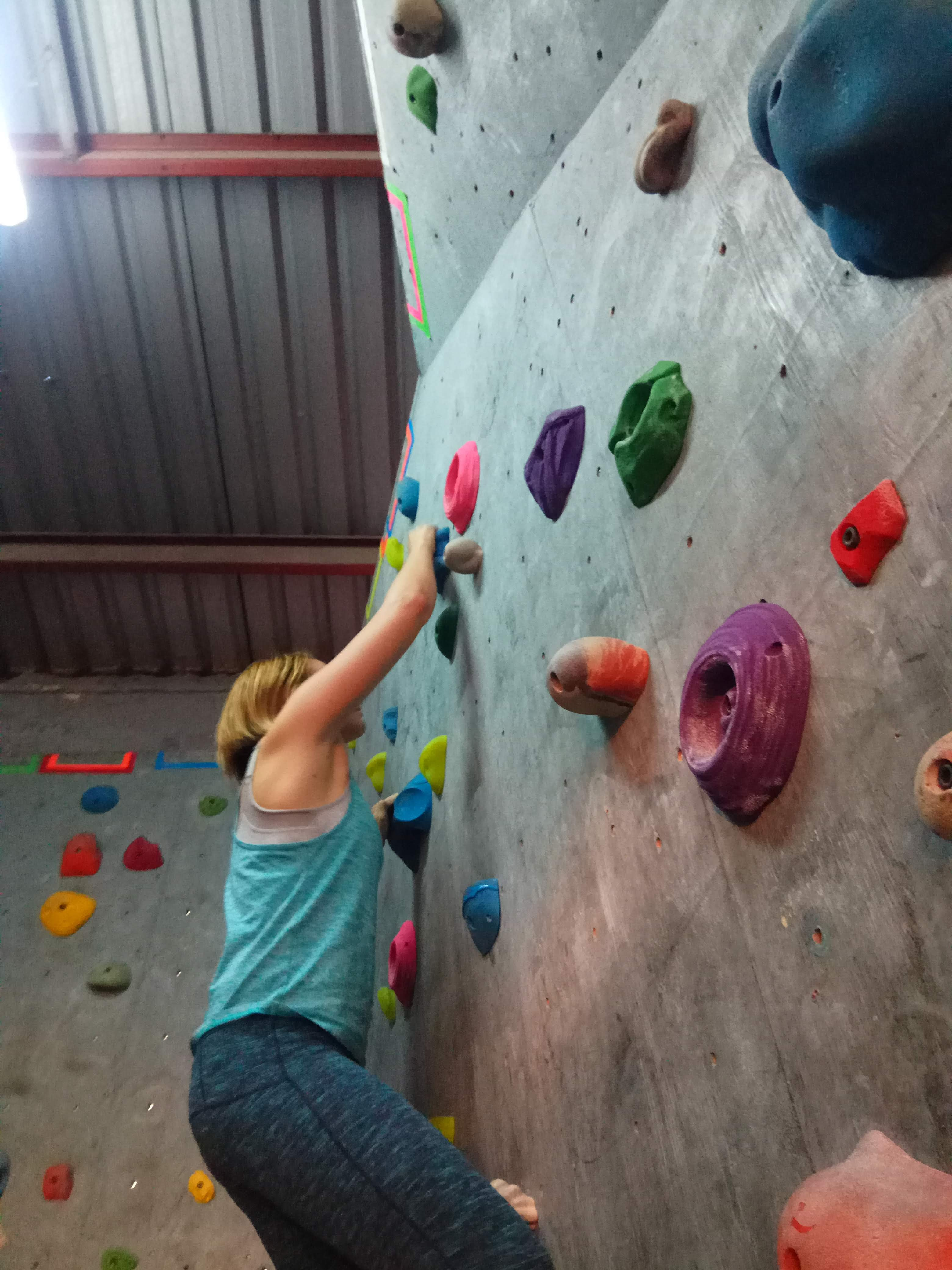 Me on the wall at BlueSky Climbing Gym