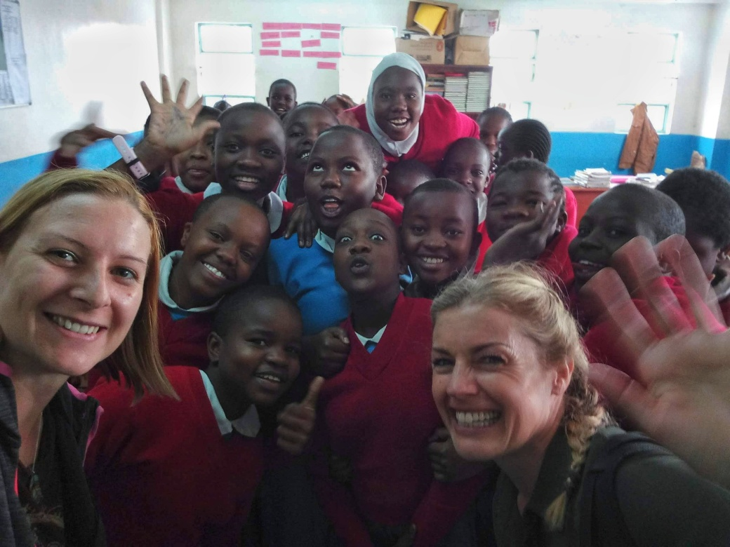 Me and Amy having a selfie with the 7th Graders at Kibera School for Girls