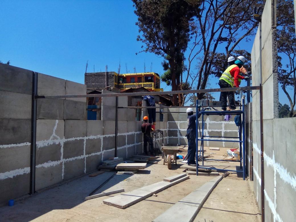 Kwangu Kwako team constructing a school