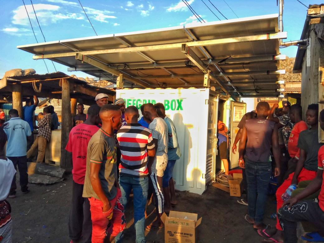 Villagers gathering around the OffGridBox