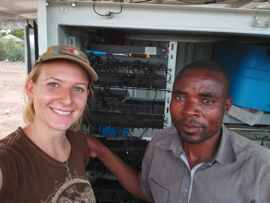 Me with my helper stood in front of the OffGridBox and the powerbank charging cables