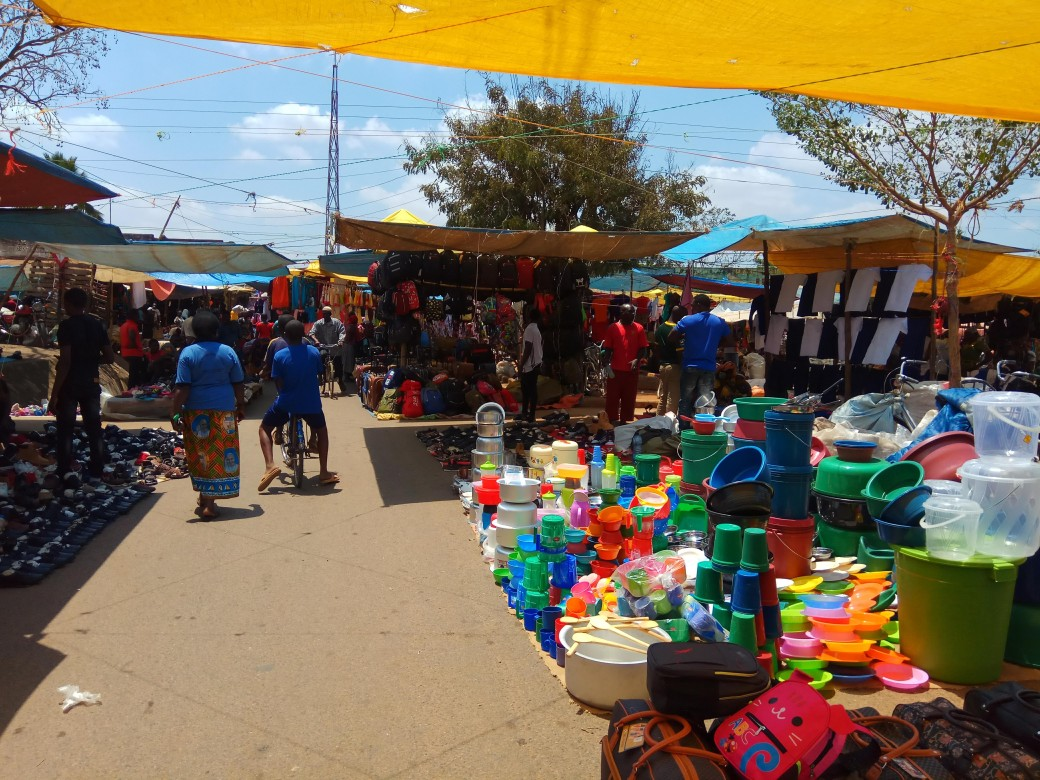 Colourful stacks of plastic pots at the Saba Saba market in Morogoro