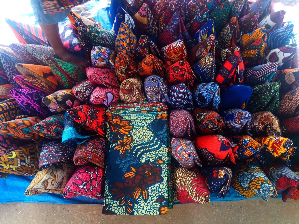 Colorful cloth folded into cones for display at the market