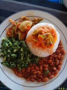 Plate with rice, beans and greens for lunch