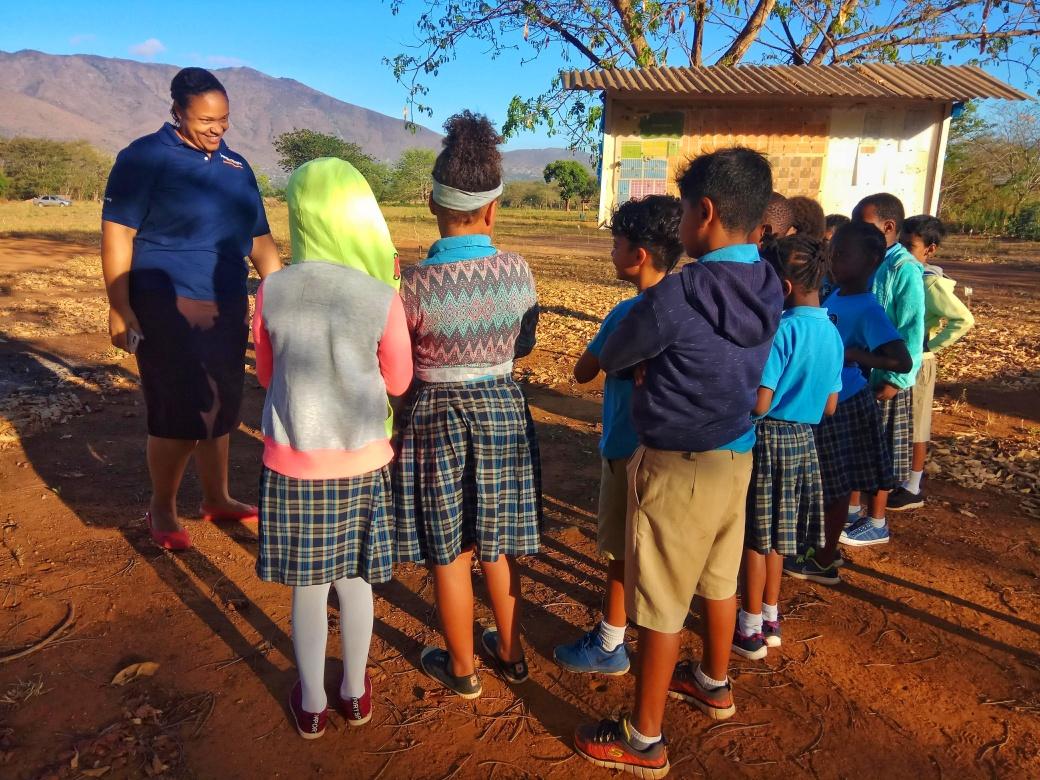 Lily speaking to schoolchildren before a minefield tour