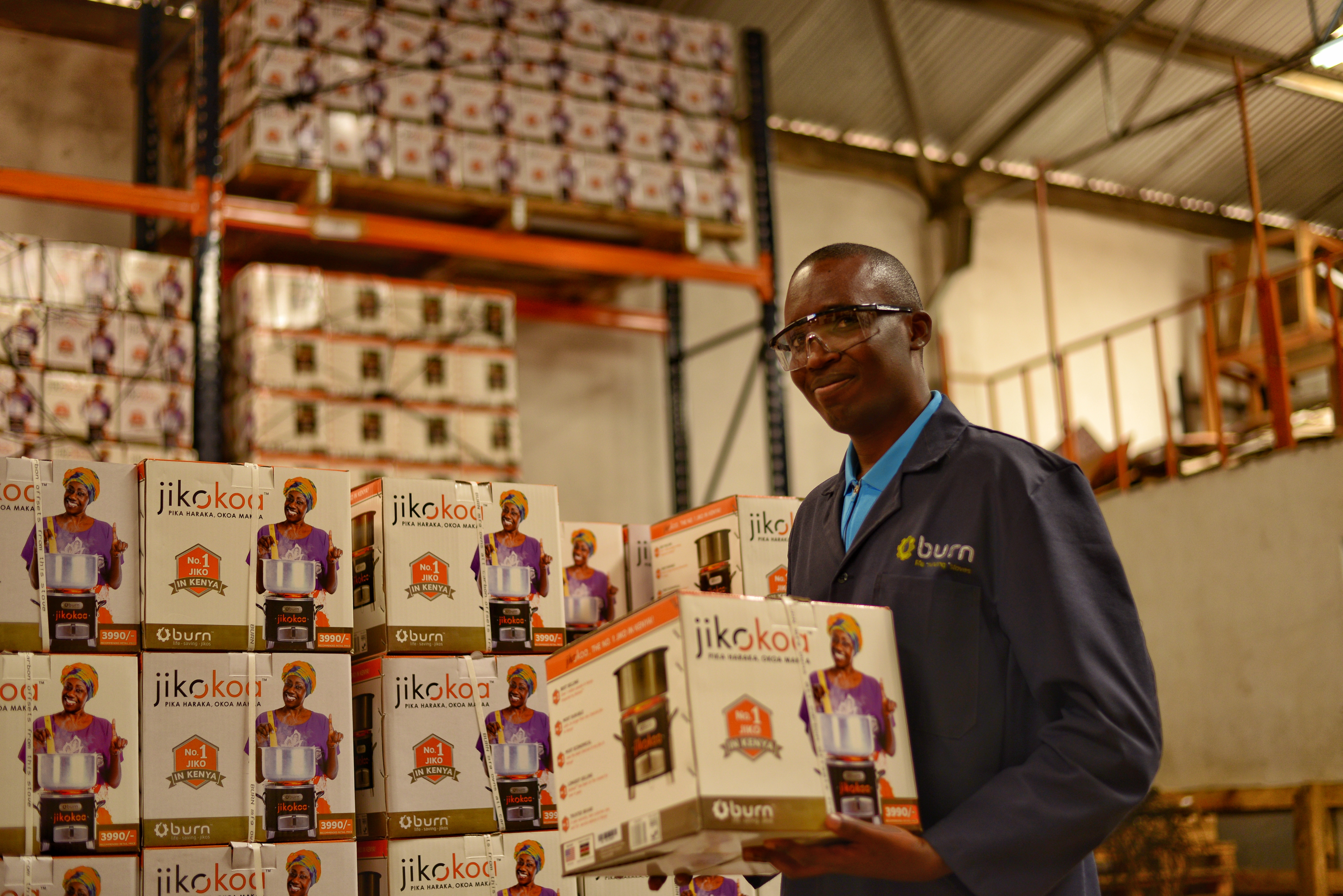 Ephantus, a Process Engineer at BURN holds a Jikokoa while giving me a tour of the factory
