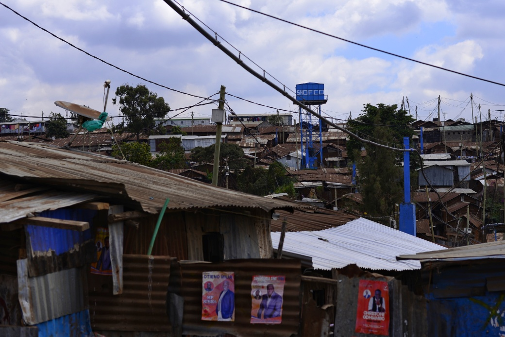 A SHOFCO water tower visible over an area of the Kibera Slum